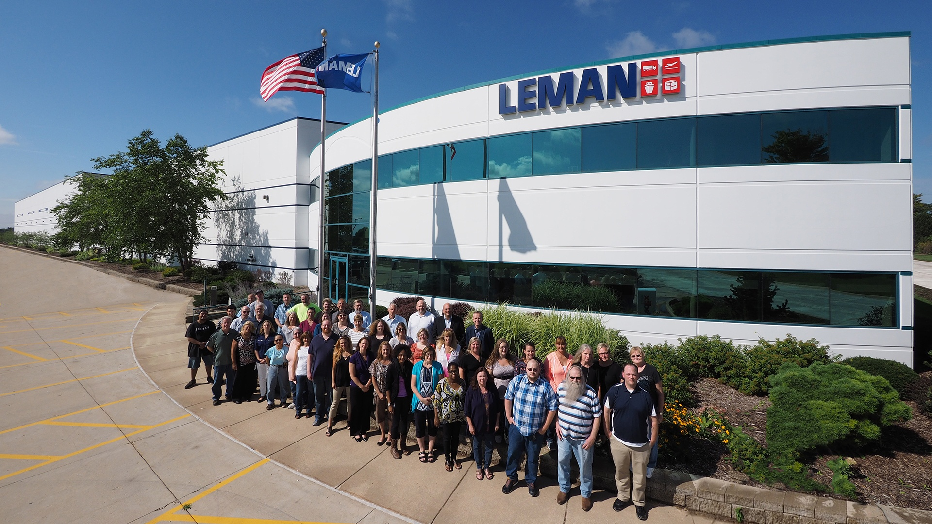 LEMAN STAFF IN FRONT OF BLDG1920x1080.jpeg